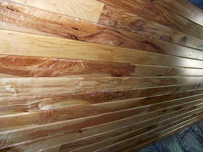 4-inch rustic birch tongue and grooved paneling with two coats of varnish for a darker look