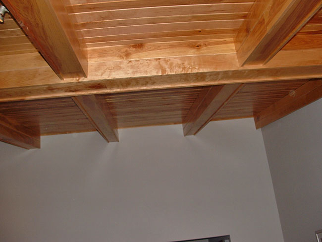 Custom birch paneling installed on the ceiling of a contractor's home in Hastings, Minnesota