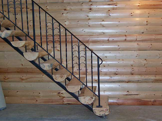 Basement wall covered with pine logs