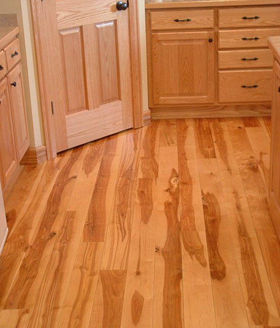 5 inch wide rustic birch flooring in kitchen with oak cabinets