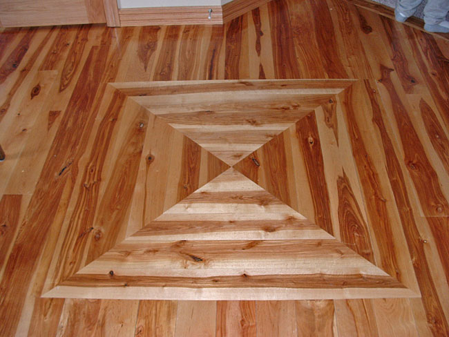 Pattern in rustic birch flooring.  This 5 inch flooring has a poly finish.