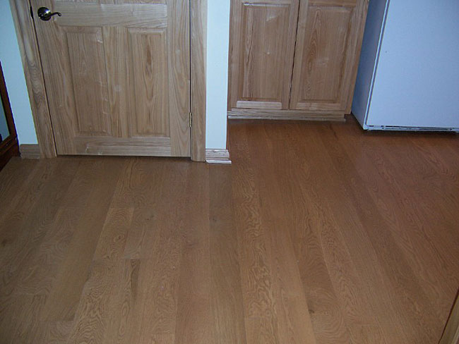 5 inch wide white oak flooring with a light stain